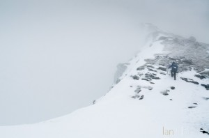 Ian Homer Photography. Striding along the snowy summit ridge in misty conditions