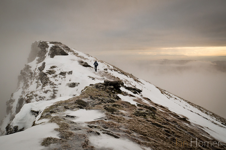 Ian Homer Photography. Ian Homer Photography. Picking the way along the snowy summit ridge - the mist suddenly clearing.