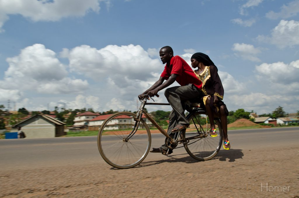 Boda boda riders ferry their fare paying passengers across the city.